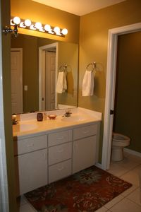 Master bathroom has walk in shower, private toilet area and jetted tub