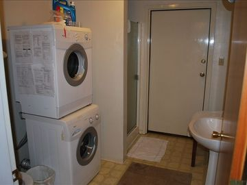 Downstairs bathroom with washer and dryer.