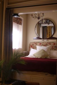 Bed nook with curtains to separate it from the room.