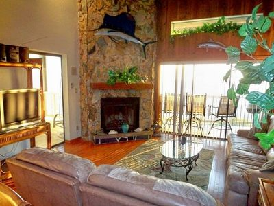 Indian Shores townhome rental - Living Room with fireplace and hardwood floors, balcony on beach