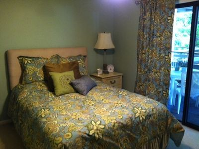 Master bedroom offers a queen bed, it's own private bathroom, opens onto lanai.
