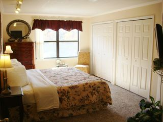 Branson condo photo - View of the Ozark Mountains. Beautiful bedroom with king bed and flat screen TV