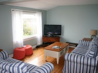 Falmouth house photo - The living room has plenty of seats plus a new flat screen & views of the ocean.