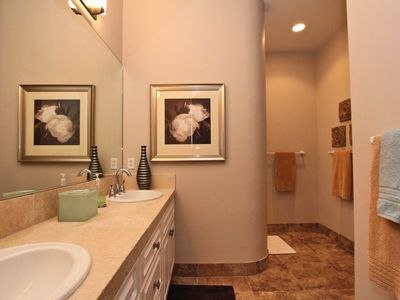 Secondary guest bath, double vanities, walk-in shower and large walk in closet
