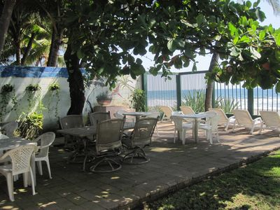 Patio area with a great view under tree. BBQ pit along wall.
