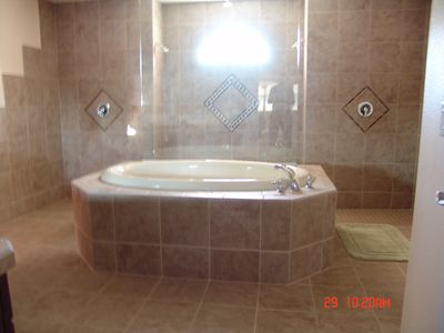 Partial View of Master Bath w/Triple Shower and Tub. Huge bathroom.