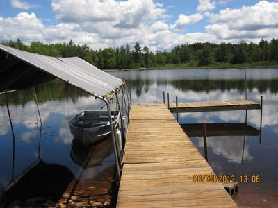 Munising cottage rental - Dock with fishing boat.