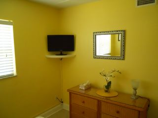 Cocoa Beach condo photo - new wicker dresser and spacious closet provide plenty of storage - 23 inch HDTV