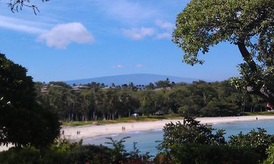 Things to do: visit Mauna Kea Beach up north with Mauna Loa in the background.