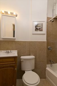 Full bathroom with bath tub and shower