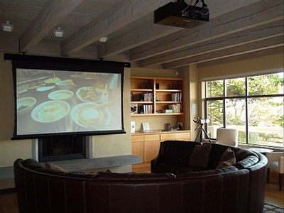 "WOW! Great room media area has 105"" projection TV and surround system"