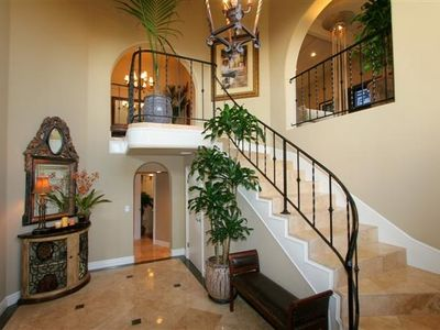 Entry way, stairs leading up to Dining, Kitchen, Family Room, Master Suite