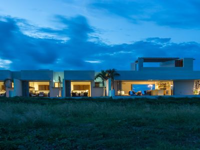 Modern oceanfront home with private pools, outdoor showers and rooftop patio.