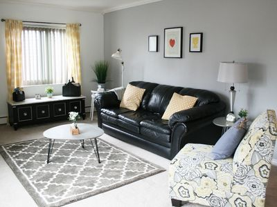 Cozy, bright living room with a sofa bed and black out blinds.