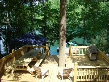 Lakeside Deck w/ Large Picnic Table, Built in Seating, and Grill
