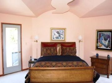 One of two Master Bedrooms with King-sized bed