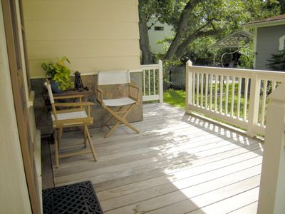The back porch is a serene spot to sip your coffee and admire the rosebushes.