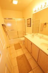 Osage Beach condo photo - The Master Bath offers a Double Vanity and Tub / Shower Combo