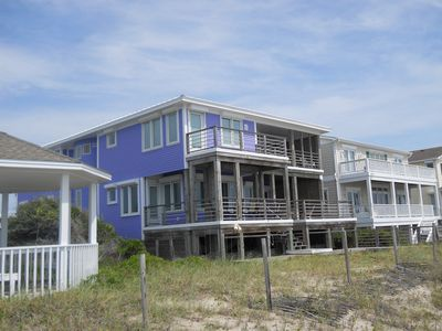 Side view of House walking from the Beach. 4 Decks on the Back of the House.