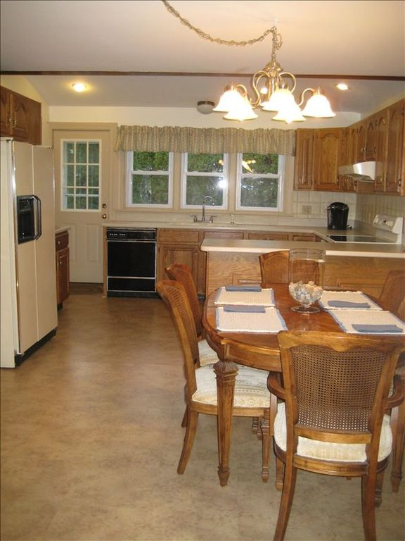 Generous sized, fully equipped eat-in kitchen. Table seats 6, expands to 10