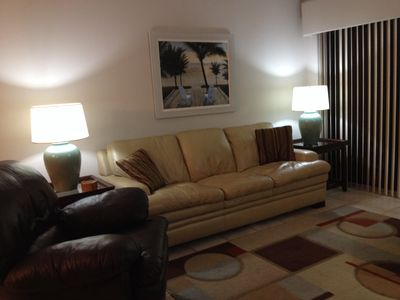 Living Room with very comfortable leather furniture and a 50 inch T.V. with DVD.