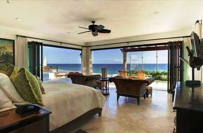 Master bedroom ON the beach, adjacent to jacuzzi and pool