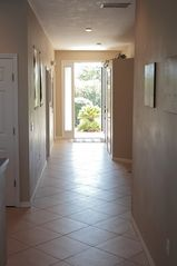 Sunset Lakes house photo - View towards Villa Entry... New Ceramic Tile Floors!