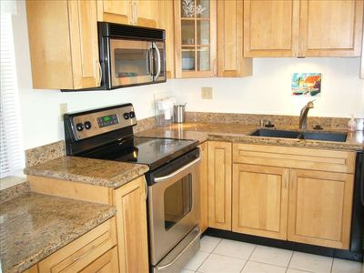 MODERN KITCHEN WITH STAINLESS APPLIANCES, GRANITE COUNTERS, LATEST COOKWARE