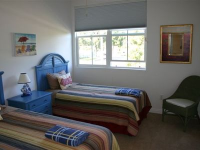 Twin Bedroom& Queen Bedroom share a full bath/double sinks/separate toilet area.