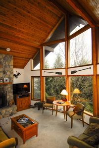 Great Room with Vaulted Cedar Ceiling and Large Windows for view.
