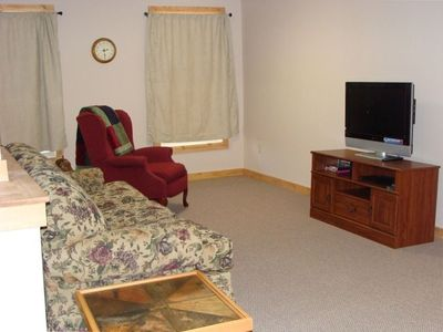 Flat screen TV and family room area in basement