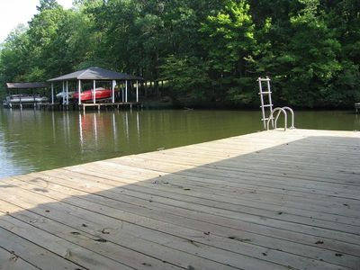 Large dock for sunbathing or swimming, with ladder for easy access