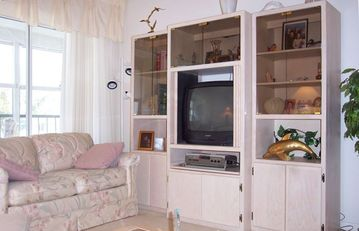 Entertainment center w/ TV and DVD player, now widescreen TV as of 4/12