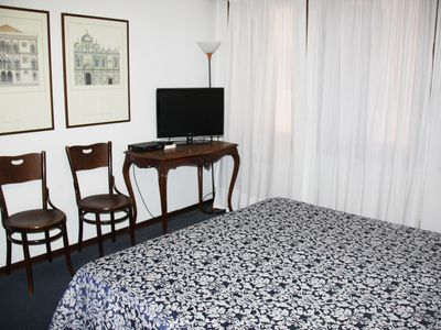 Bed room with flat TV screen and international channels