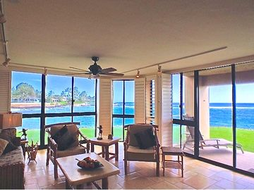 Poipu condo rental - Ground floor corner, with two walls of Glass ON the water.