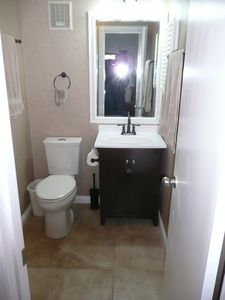 All new tile floor, wall paper, mirror, vanity, toilet, bath & light fixtures.