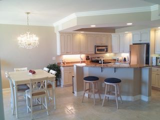 Belmont Towers Ocean City condo photo - Dinning and Kitchen area showing upgraded Ceramic Tile for easy clean up.
