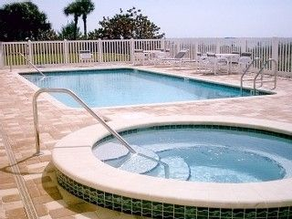 Enjoy the Heated Pool & Hot Tub --- steps from the ocean!!!!