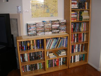 Book and video library in the living room.