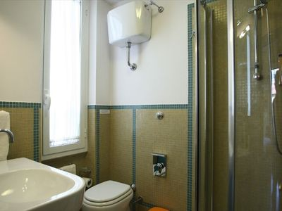 one the two bathroom with shower