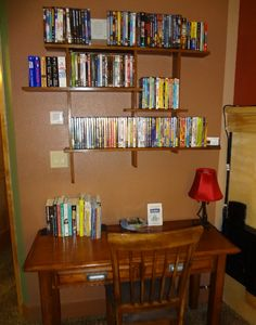 View of the work desk with the DVD library above on the wall.