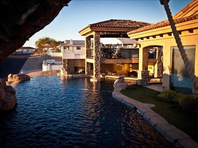Lake Havasu house rental - view of gazebo, outdoor kitchen, swim & up bar from bridge