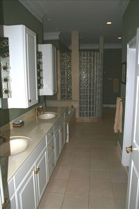 Master bathroom with walk in shower and separate tub.