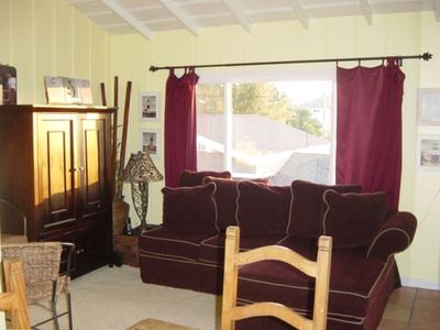 Oceanside cottage rental - Comfy living room with down sofa