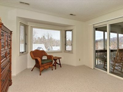 Master bedroom sitting area offers access to screen porch & large picture window