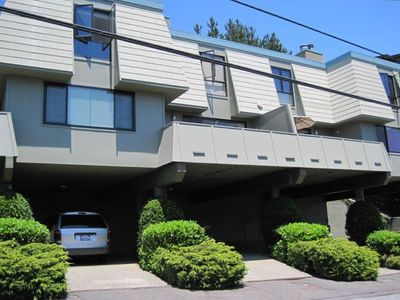 This townhouse has a wide balcony and a carport below.