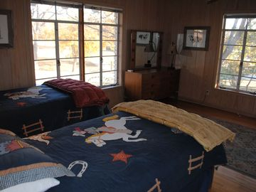 Third Bedroom with twin beds and lots of windows