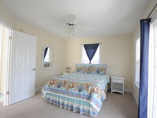 Garden City Beach house photo - Upstairs front bedroom - queen bed with balcony
