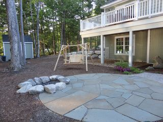 Bridgton house photo - firepit, adirondack swing, and patio
