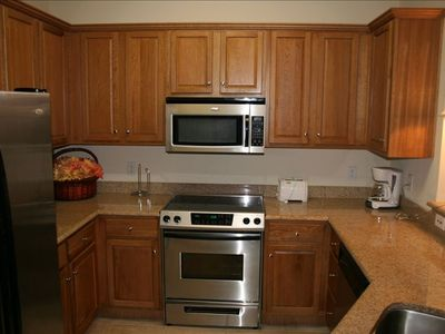 Kitchen complete with stainless steel appliances and granite countertops